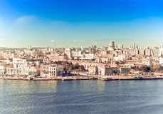 Havana. View of the old city through a bay from Morro's fortress. With a retro effect royalty free stock images