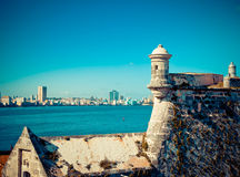 Havana. View of the old city through a bay from Morro's fortress. With a retro effect Stock Photos
