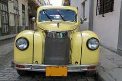 Havana yellow car. Nice yellow old car in Havana, Cuba Royalty Free Stock Images