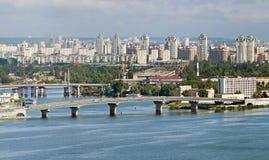Havanskiy bridge in Kiev. Havanskiy bridge across the Dnieper River in Kiev on a background of the Obolon Stock Photos