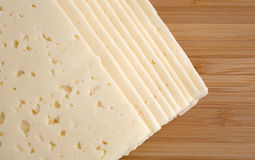 Havarti cheese slices on a cutting board Royalty Free Stock Images