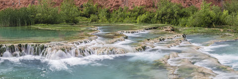 Havasu Creek Terrace Panorama. The crystal clear turquoise waters of Havasu Creek flow over travertine terraces forming pools in Havasupai Indian Reservation royalty free stock images