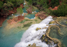 Havasu Falls. In the morning, and the mineral formed pools below Stock Images