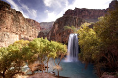 Havasu Falls. Dropping into azure pool with red rock canyon as background and autumn trees in foreground Havasupai Indian Reservation Royalty Free Stock Photography
