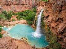 Havasu Falls in Arizona. Turquoise water fills the pool beneath Havasu Falls in Havasu Canyon stock images