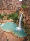 Havasu Falls in Arizona. Turquoise water fills the pool beneath Havasu Falls in Havasu Canyon stock photos
