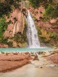 Havasu Falls in Havasu Canyon. Turquoise water fills the pool beneath Havasu Falls in Havasu Canyon. Havasupai Reservation in Grand Canyon stock photos