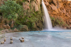 Havasu Falls Stumps. Stumps for sitting in the pool below Havasu Falls on the Havasupai Indian Reservation in the Grand Canyon royalty free stock image