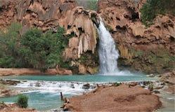 Havasu Falls. Turquoise water fills the pool beneath Havasu Falls in Havasu Canyon stock photo