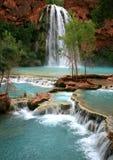 Havasu Falls Waterfall. The stunning Havasu Falls waterfall cascades eighty feet into a turquoise blue travertine pool on the Havasupi Indian Reservation in the stock image