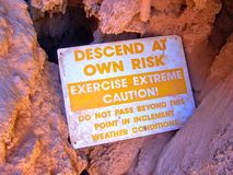 Havasupai Falls Danger Sign, pools, blue water, geological formation rock walls Stock Photo
