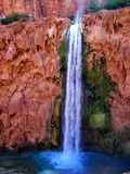 Havasupai Falls Hike Landscape, pools, blue water, geological formation rock walls Stock Image