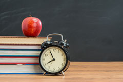 Have apple for school lunch you won`t be late anymore Stock Images