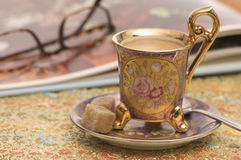 Have a break. A cup of coffee in an antique porcelain cup Royalty Free Stock Image