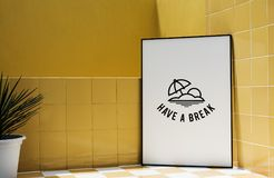 Have a break board on yellow wall Stock Image
