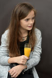 Have a break. Young photographer has  a break, drinking orange juice Royalty Free Stock Photos