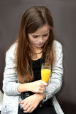 Have a break. Young sad and tired  photographer has  a break, drinking orange juice Royalty Free Stock Photo
