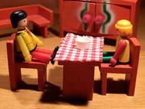 Have a chat!. Toy figures at the kitchen table Stock Image