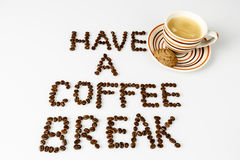 Have a coffee break from beans on white with cup of coffee. Text have a coffee break from beans on white with cup of coffee and cookie or biscuit Royalty Free Stock Photo
