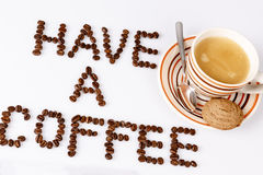 Have a coffee break from beans on white with cup of coffee. Text have a coffee break from beans on white with cup of coffee and cookie or biscuit Royalty Free Stock Images