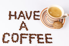 Have a coffee break from beans on white with cup of coffee. Text have a coffee break from beans on white with cup of coffee and cookie or biscuit Stock Photos