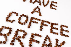 Have a coffee break from beans on white. Text have a coffee break from beans on white Royalty Free Stock Images