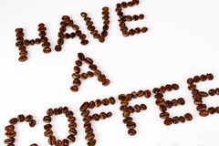 Have a coffee break from beans on white. Text have a coffee break from beans on white Royalty Free Stock Image