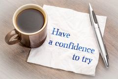 Have confidence to try advice on napkin. Have confidence to try advice - handwriting on napkin with a cup of coffee Stock Photos