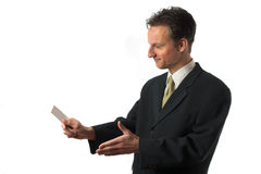 So we have a deal?. Businessman reaching out his hand to sign the deal while giving his businesscard stock image