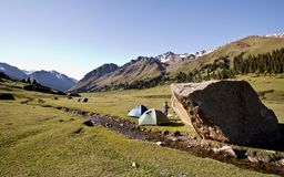 Camping in a mountain valley in Kyrgyz mountains. We have decided to camp during our last day descending from Tian Shan mountains in Kyrgyzstan Royalty Free Stock Images