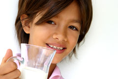 Have a drink. Happy nine year old girl holding a glass of milk. Enough copy space Fit for health, growing, nutrition, dental, happy child, etc, layout royalty free stock images