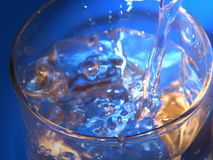 Have a drink. Studio shot of pouring water royalty free stock photography