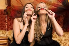 Have fun. Two beautiful women are having fun Royalty Free Stock Photography