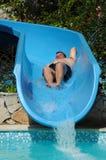 Have fun on aqua park. Happy fat man have fun on aqua park Stock Photography