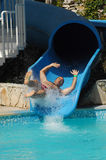 Have fun on aqua park. Happy fat man have fun on aqua park Royalty Free Stock Images