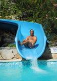 Have fun on aqua park. Happy fat man have fun on aqua park Stock Images