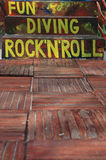 Have fun with diving and rock and roll Royalty Free Stock Photo