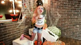 Have fun at halloween party, harley quinn threatens with baseball bat, happy little girl, halloween stock video