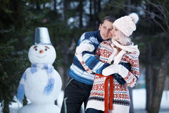 Have fun and laughs next to the snowman Stock Photography