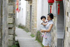 Have fun with monther, Chinese classic woman and baby in cheongsam Stock Photography
