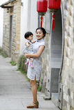 Have fun with monther, Chinese classic woman and baby in cheongsam Stock Photos