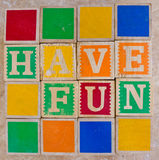 HAVE FUN spelled out. In a child's alphabet blocks remind us to keep part of our childhood with us throughout life stock photography
