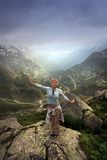 Have a fun in swiss alps. Alone woman hike in the sunny swiss Alps, 2400 m Stock Photo