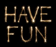 Have fun text written with sparkler letters Royalty Free Stock Photography