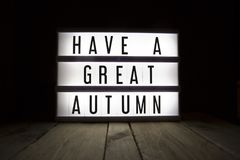 Have a great autumn. `Have a great autumn` text in lightbox stock illustration