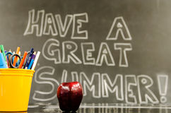 Have a Great Summer. Image of a classroom with Have a Great Summer written on the blackboard Royalty Free Stock Image