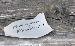 Have A Great Weekend. Hand writing text on a piece of paper on wood background Royalty Free Stock Photography