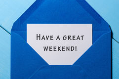 Have a Great weekend - wish at blue envelope. business concept.  Royalty Free Stock Photography