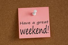 Have a great weekend written on note. Have a great weekend written on remember note with pin on cork board Stock Photography