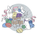Have a Happy Easter. Easter bunny with colored eggs. Stock Image